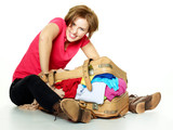 Pretty woman packs her overcrowded bag for holidays poster