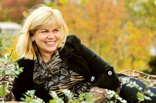 middle age woman in fall time