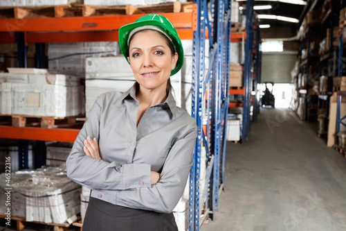 Confident Female Supervisor With Arms Crossed