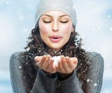 Fototapety Christmas Girl. Winter woman Blowing Snow
