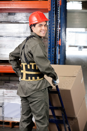 Warehouse Worker Pushing Handtruck