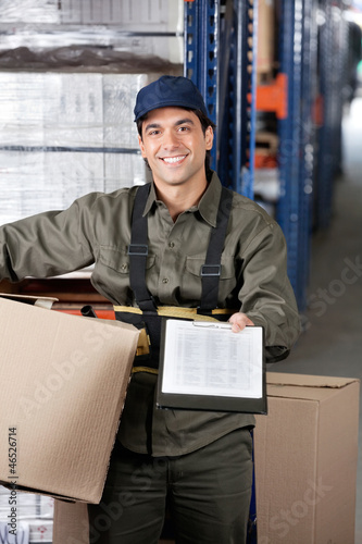 Male Supervisor With Clipboard And Cardboard Box