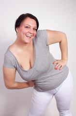 Cheerful overweight woman posing in sporty clothing