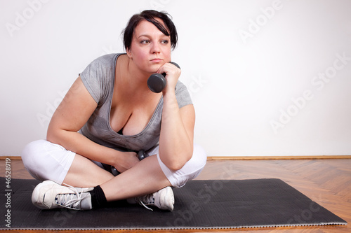 Overweight woman is fed up and tired of exercising