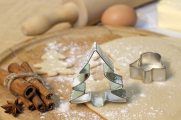 Christmas baking cookies with tree shape on blurred background