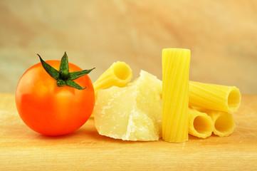 Raw tortiglioni pasta with parmesan and cherry tomato