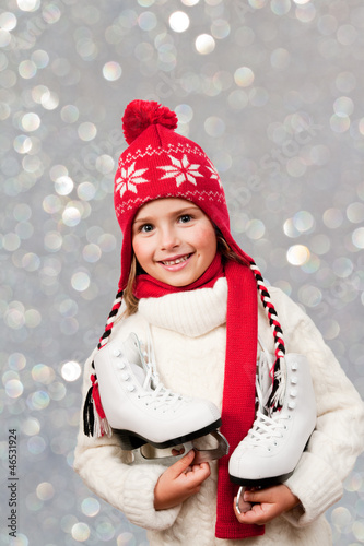 Ice skating - cute girl with ice skating boots