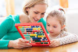 Mother and daughter with abacus