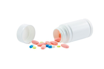 Spilled container of medicines isolated on white