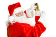 Santa Claus Stuffs a Christmas Stocking