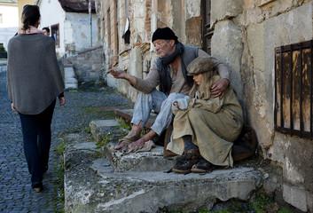 Beggars are begging for money on the street