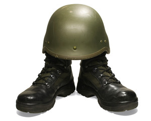 Soldier visual concept. Military boots and helmet