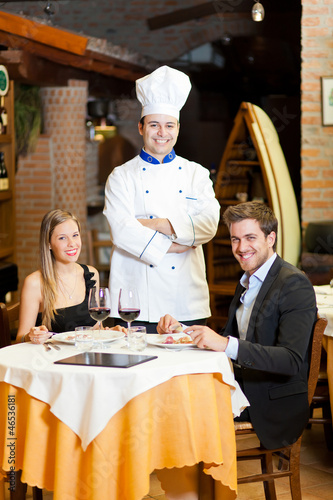 Couple at restaurant ordering from the waiter