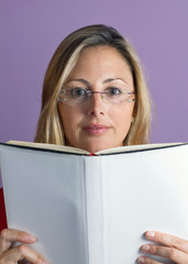 woman reading a book white cover