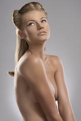 portrait of naked blonde girl, she looks up
