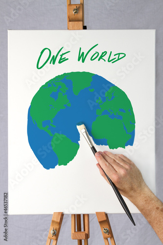 Artist painting a picture of the earth on a canvas
