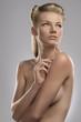 portrait of naked blonde girl, she looks at left