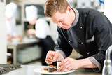 Fototapety Chef as Patissier cooking in Restaurant dessert