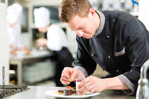 Chef as Patissier cooking in Restaurant dessert