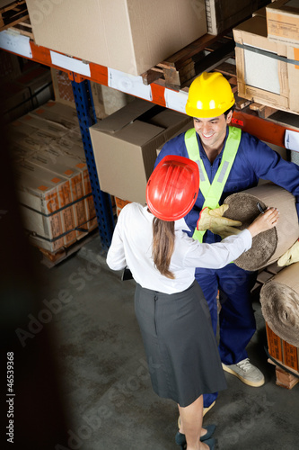 Female Supervisor Communicating With Foreman