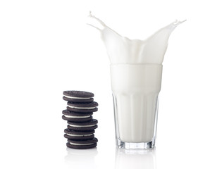 Splash of milk with various chocolate cookies