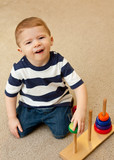 Developmentally delayed child with stacking toy