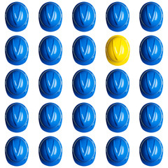 yellow and blue hardhats on white background