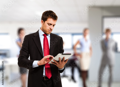 Businessman using his tablet