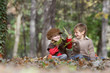 two young happy children - boy and girl - on natural autumn back