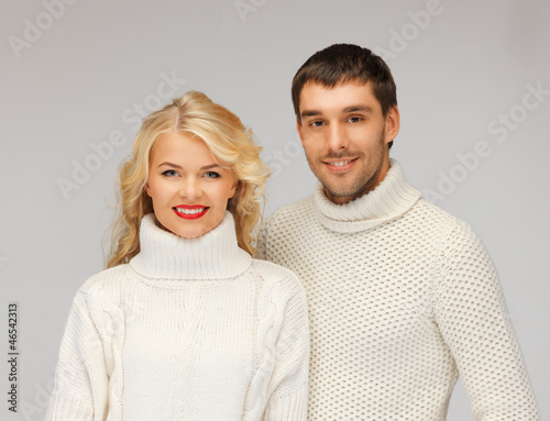 family couple in a sweaters