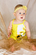 Little baby girl in yellow clothing