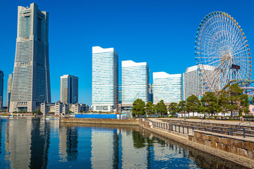 Buildings at Minato-Mirai Yokohama reflected in the river.