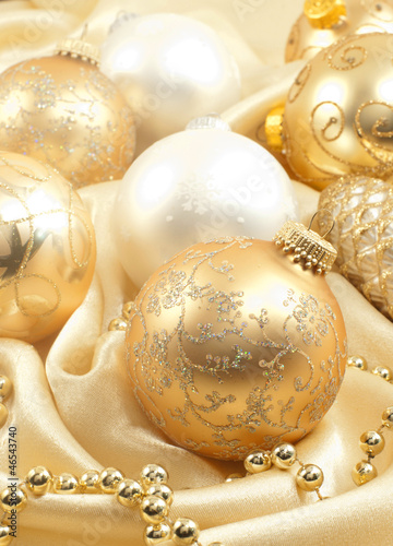 Christmas ornaments on golden silk