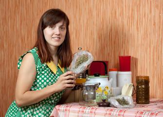 Woman brews herbs
