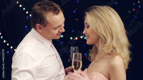 Handsome man brings champagne to girlfriend  and kissing