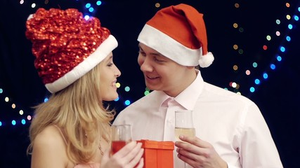 Happy  man giving present to girl  at christmas party
