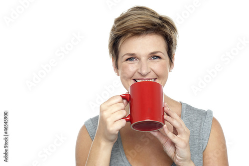 Young woman enjoying her coffee