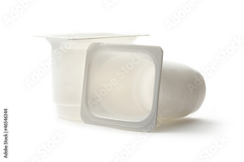 Empty plastic yoghurt pots on white