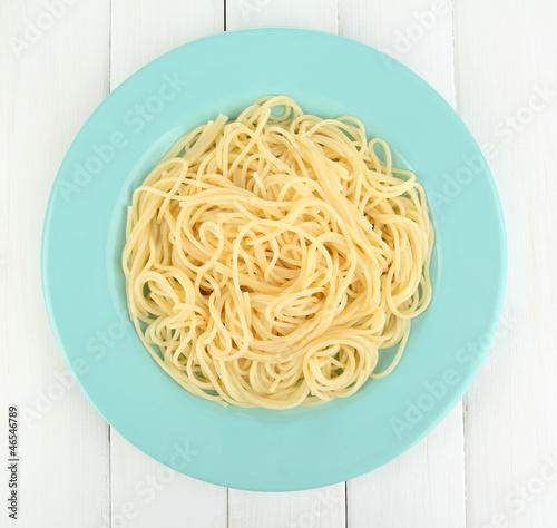 Italian spaghetti in plate on wooden table