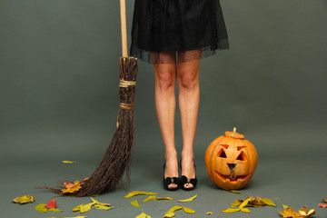 Halloween background with pretty female legs