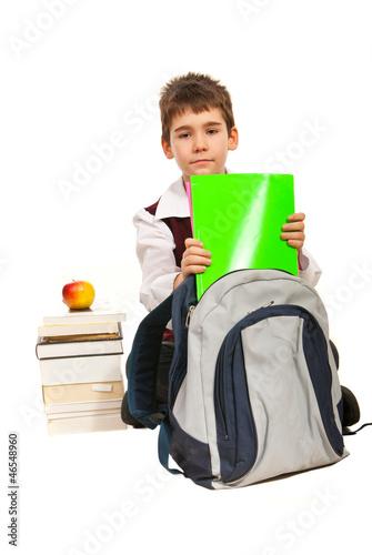 Student boy prepare to make homework