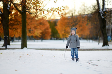 Little girl having fun at winter city