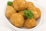 Breaded deep fried mushrooms garnished with parsley