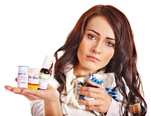 Woman having pills and tablets.