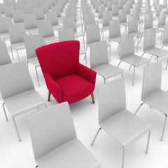 Roter Sessel zwischen den Stühlen