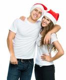 Beautiful Christmas couple in Santa hats