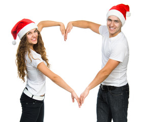Beautiful Christmas couple in Santa hats