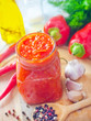Fresh chilli sauce in the glass bank