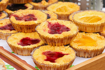 Fresh cakes with strawberry and peach
