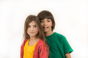 Girl and boy posing on white background